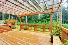 Walkout deck overlooking backyard landscape Stock Photos