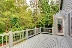 Walkout deck overlooking green belt Stock Images