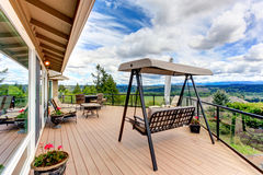 Walkout deck with patio area and garden swing Royalty Free Stock Image