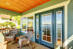 Walkout deck with wicker chairs. Stock Photos