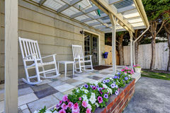 Walkout patio area with white rocking chairs Royalty Free Stock Image