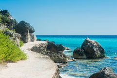 Walkpath close to the shore on tropical island royalty free stock photos