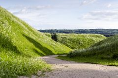 Walkpath between Kernavė mounds. Kernavė mounds are located on the southern outskirts of Kernavė town Lithuania, on the right bank of the Neris valley Royalty Free Stock Images