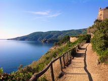 Walkpath in Porto Azzurro,  Italy. Hiking in tuscan archipelago, scenic view of walkpath in Porto Azzurro, Elba island, Italy Royalty Free Stock Photography