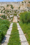 Walkpath to XI Century fortress in the Italian countryside. Walkpath to a XI century brick walls fortress guarding a small village in the Italian countryside Stock Photography