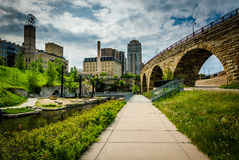 Walkwak and The Stone Arch Bridge at Mill Ruins Park, in downtow Royalty Free Stock Photo