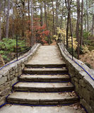 Walkway. A stone walkway that was built in a forest Royalty Free Stock Images