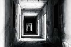 Walkway in abandoned building with scary woman inside. Darkness horror and halloween background concept Royalty Free Stock Photo