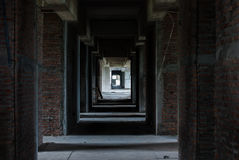 Walkway in abandoned hotel Stock Images