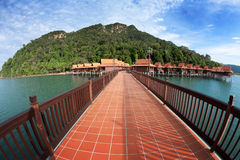 Walkway above water towards beautiful chalet Stock Image
