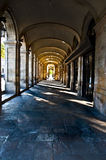 Walkway with aches. Walkway lined with arches in Barcelona Spain Royalty Free Stock Image