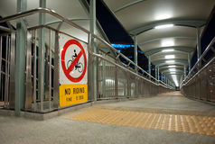Walkway across a bridge with a no riding sign Stock Image