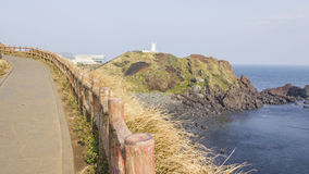 Walkway along cliff destination to lighthouse view with ocean Stock Photography