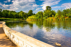 Walkway along a pond at Patterson Park, Baltimore, Maryland. Stock Photo