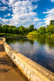 Walkway along a pond at Patterson Park, Baltimore, Maryland. Royalty Free Stock Photo