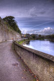 Walkway along the River Nore. Old concrete walkway following the Rive Nore in Kilkenny, Ireland Stock Images