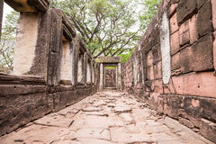 Walkway in ancient castle with windows and door stone inscription among nature, pimai castle Royalty Free Stock Photos