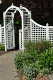 Walkway with arbor. This arbor is very welcoming and attractive. There are plants along the walkway Stock Photo