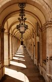 Walkway with arches. Walkway lined with arches and decorative light fixtures in Lisbon, Portugal stock photos
