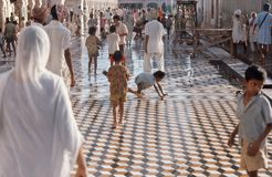 1975. India. Walkway around the Golden Temple. Amritsar.. Children are cleaning the walkway around  The Golden Temple Royalty Free Stock Photos