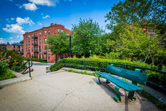 Walkway and bench at Southwest Corridor Park in Back Bay, Boston Royalty Free Stock Images