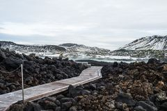 Walkway in the Blue Lagoon, Iceland winter season with snow-capp. Ed mountain in the background. The Blue Lagoon is geothermal spa is a world class spa. One of Stock Photography