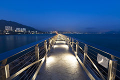 Walkway bridge along the coast at night Royalty Free Stock Photos