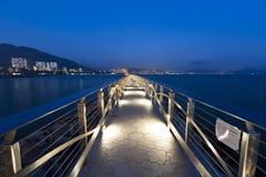 Walkway bridge along the coast at night Royalty Free Stock Photos
