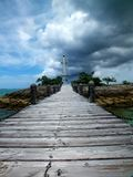 Storms over the lighthouse on a sunny day. royalty free stock photo