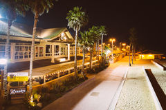 Walkway and buildings along the beach at night  Royalty Free Stock Photo