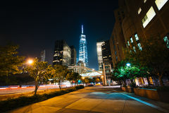 Walkway and buildings in Lower Manhattan at night, New York. Royalty Free Stock Photos