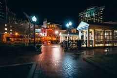 Walkway and buildings at night, in Norfolk, Virginia. Stock Image