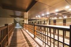 Walkway between buildings in night Royalty Free Stock Photos