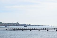 Walkway cement bridge over the sea and shore background Stock Image