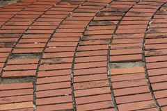 The walkway is covered with brown tiles. stock photos