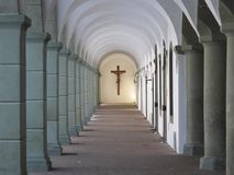 Walkway with cross at abbey Royalty Free Stock Images