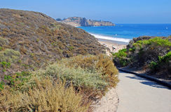 Walkway through Crystal Cove State Park to Beach. The image shows a walkway to the  beach in Crystal Cove State Park. Abalone Point can be seen in the Stock Images
