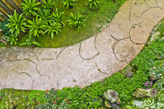 Walkway in a decorative garden Stock Photography