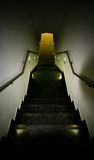 A walkway down a steep stairwell Royalty Free Stock Images