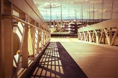 Walkway down to the marina Stock Photo