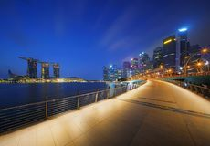 Walkway at downtown Singapore city in Marina Bay area. Financial. District and skyscraper building at sunrise royalty free stock image