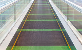 Walkway escalator at airport terminal Stock Photo