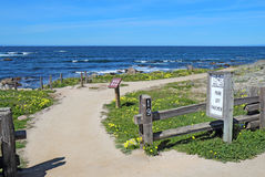 Walkway, fence and signs at Asilomar State beach in Pacific Grov Stock Image