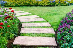 Walkway. In the flowers garden Royalty Free Stock Images