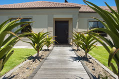 Walkway and front door of a house Stock Images