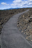 Walkway going through lava rock Royalty Free Stock Photography