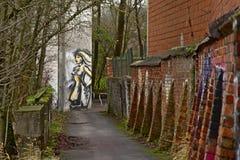 Walkway with graffiti of woman Royalty Free Stock Photos