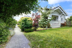 Walkway with green bushes alongside. House exterior Stock Images