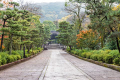 Walkway with green forest to Buddhist Temple in Kyoto, Japan Stock Photo