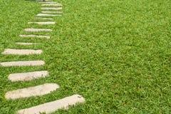 Walkway on green grass Stock Photography